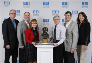From left to right: Bob Powers, vice chairman, AEP; Nick Akins, chairman, president and CEO, AEP; Meihuan Fulk, principal engineer, AEP Transmission;  Richard Gutman, staff engineer, AEP Transmission; Tom Kuhn, president, EEI; and Lisa Barton, EVP, AEP Transmission